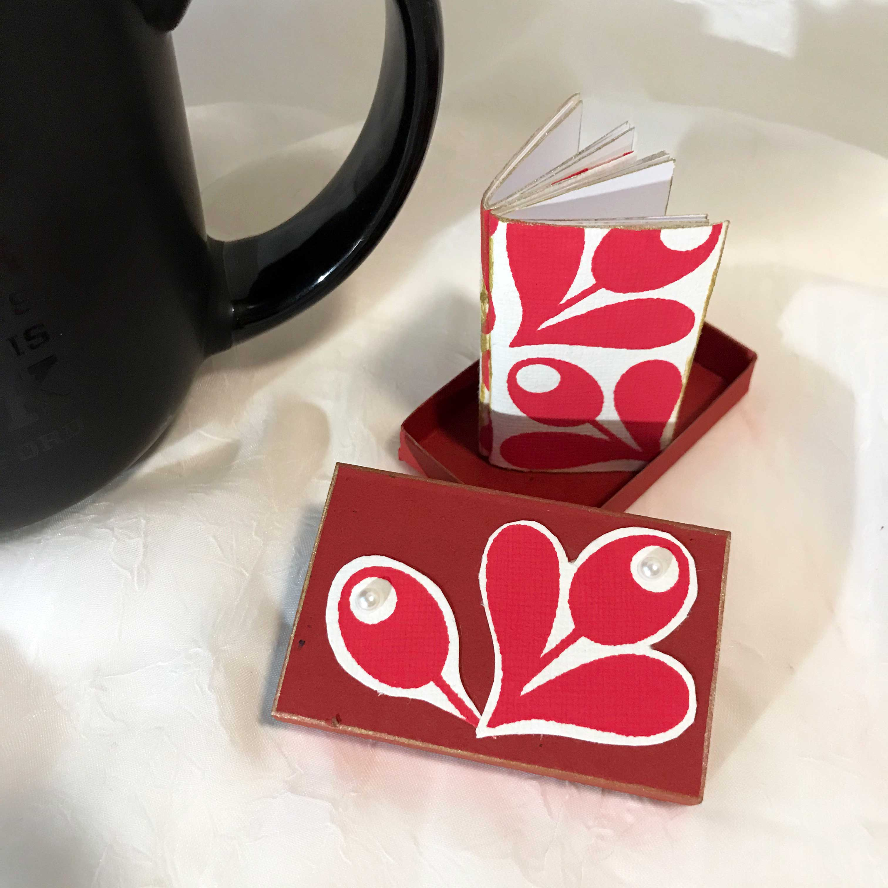 Red Matchbox with mini book inside. alt=